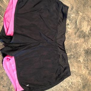Black mesh shorts with built in pink spandex